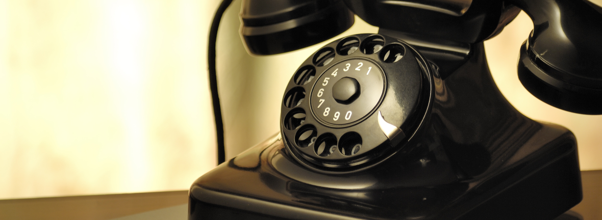 A photograph of an old-fashioned telephone