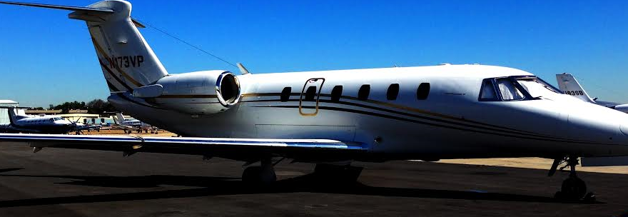 Cropped photo of a private jet. Image © Melanie Greenwood